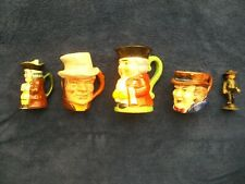 A Collection of 4 English Toby Jugs & 1 Cast Iron Amish Figurine