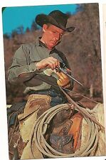 WESTERN COWBOY RELOADS His Gun Pistol Revolver Postcard Black Hat on Horseback
