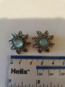 A Beautiful Pair Of silver tone Clip On Earrings With Pale Blue Stones