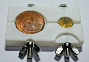 White Coin holding clamp / vice, for cleaning and inspecting coins.