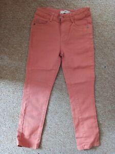 Childs orange / peach chinos / jeans. Age 6years
