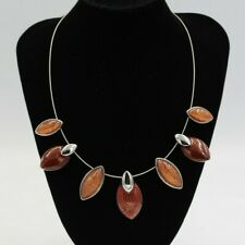 Wire necklace with orange/brown foil backed resin marquise shaped cabochons
