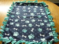 Handmade fleece tie blanket of paws and bones for a small pet (blue/teal)