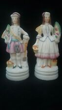 PAIR OF GEORGIAN BISQUE FIGURINES OF 17TH CENTURY LADY & GENT VEGETABLE DIGGERS