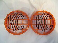 "2 KC LIGHT COVER, KC HILITES 6"" GRILL GUARDS ORANGE/BLK COLORED KC LIGHT COVERS"