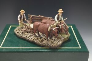 1997 COLONIAL WILLIAMSBURG PLOWING  WITH OXEN WISE AND LANG VG IN BOX