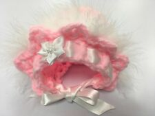 Crochet baby bonnet trimmed with marabou fur and satin ribbon
