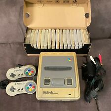 Super Nintendo SNES in good condition with cables + 2 controllers + 17 games
