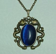 MYSTICAL DARK GOLD PLATED DRAGON PENDANT WITH BLUE GLASS STONE