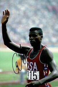 Carl Lewis Signed 12X8 PHOTO DISPLAY Olympic Legend USA AFTAL COA (D)