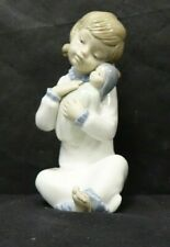 NAO LLADRO SEATED GIRL WITH DOLL               (CHI)