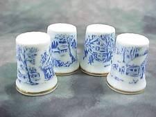 4 Thimbles Vintage Porcelain JAPAN 4 different scenes Gold Rim Blue & White