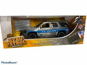 Jada 1:24 20th Anniversary Hero Patrol 2010 Chevrolet Tahoe Raw Metal Police Car