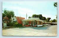 Daytona Beach, FL - SANS SOUCI MOTEL - c1950s ROADSIDE POSTCARD - OLD CARS