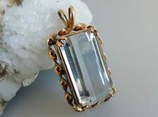 Large 23 carat natural blue topaz 14k pendant