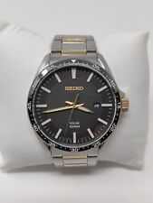 SEIKO Silver, Black and Gold Stainless Steel Solar Men's Watch SNE485P1