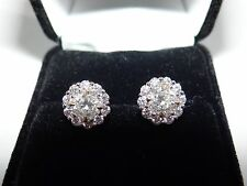 2.85 Diamond Stud Earrings in halo mounting.