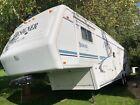 2000 Jayco 5th wheel 3 slide out camper Designer 34 foot.