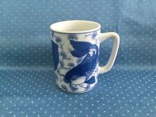 Porcelain cup, blue on white fish motif, clean, no chips or cracks