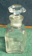 Small glass vintage bottle with stopper