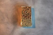 Gold coloured chargeable lighter -  working
