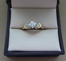LOVELY 14K YELLOW GOLD .57 TCW ROUND DIAMOND SOLITAIRE RING W/ HEART CLUSTERS