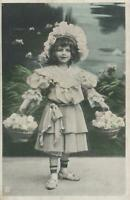VINTAGE EXTREMELY PRETTY YOUNG GIRL in BEST DRESS & HAT & BASKETS ROSES POSTCARD