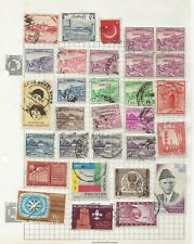 Pakistan Stamps on 2 Old album pages. Officials, 3 Paisa Block of Service, etc.