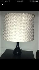 two black and white lamps