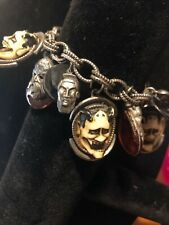 Antique FLORENZA bracelet  featuring HAND CARVED DEVILS FACES ON IT.