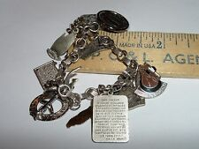 "VINTAGE STERLING SILVER CHARM BRACELET 9 STER CHARMS ABOUT 7 1/2"" 29.29 GRAMS"