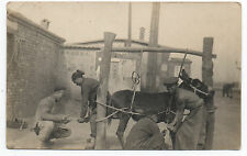 Great 1920s China RPPC Postcard of 4 Blacksmiths Shoeing a Donkey