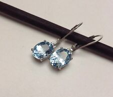 Sterling Silver Oval Cut Natural Sky Blue Topaz Lever Back Earrings 4.24CTW