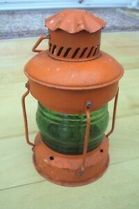 VINTAGE INDUSTRIAL LOOKING CANDLE HOLDER WITH HANGING HANDLE.