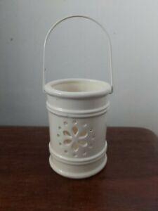 Cream Ceramic Hanging Tea Light Holder with flower Design.10cm tall  7cm diam.