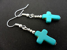 A PAIR OF TURQUOISE BLUE  SILVER PLATED CROSS EARRINGS. NEW.