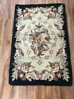 TWO VINTAGE RECTANGULAR FLORAL HOOKED RUGS WITH BLACK BACKGROUND MADE IN JAPAN