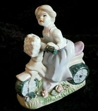 Vintage porcelain woman on bike w/ puppies in basket made in China collectible