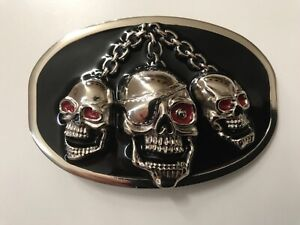 Men's multi-skull belt buckle with chain.nickel plaited . black and red enamel.
