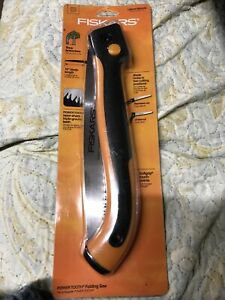 """Fiskars Power Tooth Folding Saw.   10"""" Blade locks in two cutting positions"""