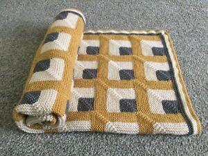 Handmade 'metered squares' knitted baby blanket in ochre / cream / grey