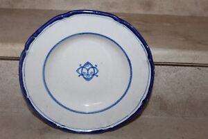 Ancienne assiette en faience de montagnon ( décor bleu et blanc)