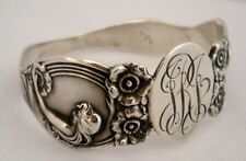 AMERICAN ART NOUVEAU UNGER BROTHERS STERLING NAPKIN RING QUEEN OF THE FLOWERS