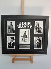 UNIQUE PROFESSIONALLY FRAMED, SIGNED JOHN WAYNE PHOTO COLLAGE WITH PLAQUE.