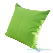 3 lime green cushions