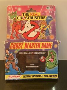 """The Real Ghostbusters """"Ghost Blaster Game"""" Vintage Hand Held Lcd Screen Game"""