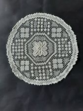 Vintage crocheted round cream doily with floral centre.