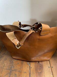 large tan leather tote bag
