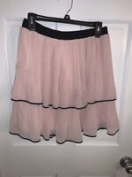 Pink Skirt With Black Trim, Hits At Or Right Above Knee.