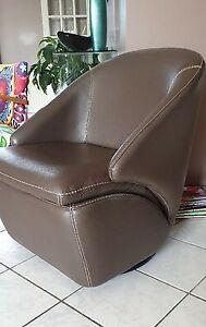 Swivel leather armchair